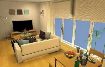 大きなソファで、ゆったりとくつろげるリビングルーム